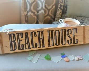 Beach House with rope, wooden sign
