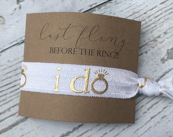 "Wedding + Bachelorette + Bridal shower hair tie favours.  Persolanized gold ""I Do"" Wedding + Bridal Shower + Bachelorette favours."