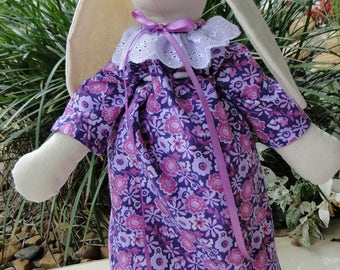 Childs soft toy calico girl bunny dressed in sweet purple floral dress and pants. Variations: Pink floral, pink rosebud,  and blue clothes.
