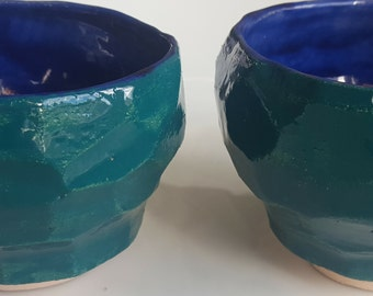 Two bowls in stoneware with blue and green enamel