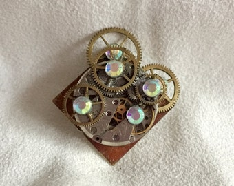 Bespoke, one-off steampunk jewellery made with real watch and clock parts