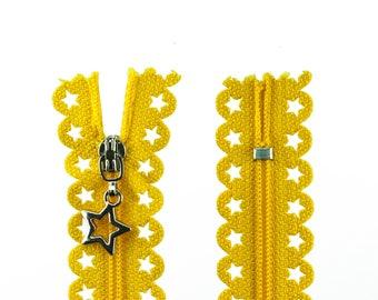 1 zip with stars 25cm yellow