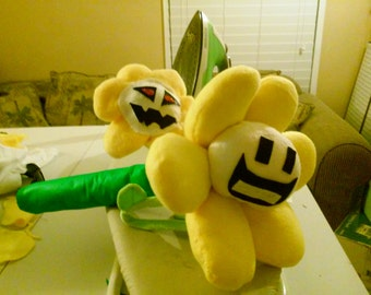 Undertales happy face flowey plush  or red eyed flowey plush or the set