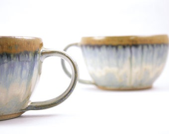 2 soup mugs. pair of handmade mugs. large pottery mugs. flowing light blue glaze. handmade in ithaca. under the tree.
