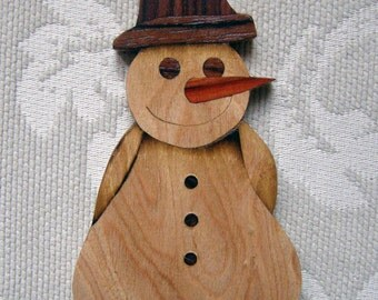 Man of snow, ornament Christmas of marquetry