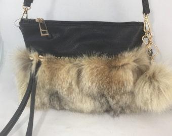 Black hand-held bag with LYNX fur
