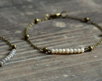 very fine glass beads bracelet nude or grey