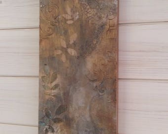Abstract collage on wood,gold and grey picture,