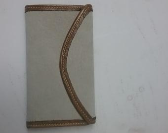 handmade leather clutch
