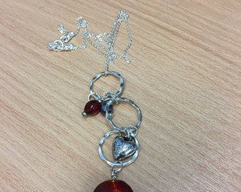 Red glass bead and silver plate pendant