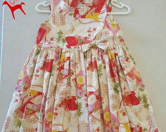 Oriental fabric key-hole dress Size 6-7 years