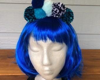 Pompom headband in multi coloured blues