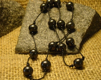 Shungite necklace of beads on a string of 10 mm. from Karelia