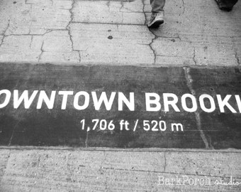 Downtown Brooklyn sign in concrete; Brooklyn Bridge, New York City; black and white photography; bedroom; living room