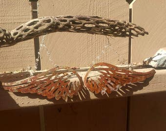 Wings with a bit of rusty patina, large statement earrings.
