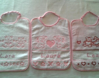 Bib embroidered in cross stitch