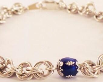 Silver bracelet with blue enamel beads