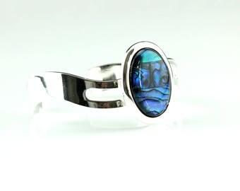 Pretty blue Paua shell on a silver plated wave style cuff bracelet.