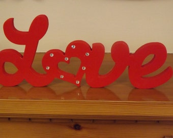 Wooden painted love sign
