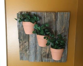 Decorative wood with terra cotta pots