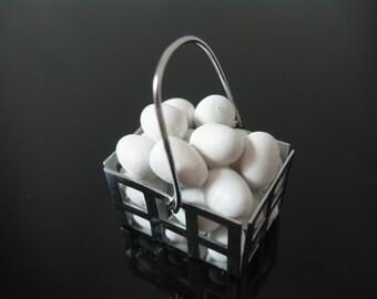 Miniature dolls house basket full of eggs