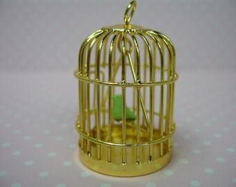 Miniature dolls house bird cage with bird