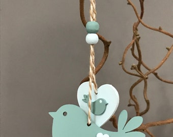 Wooden hanging bird and heart