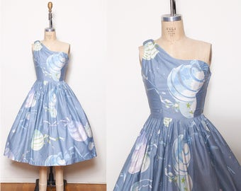 Vintage 50s blue novelty print dress / balloon print / asymmetrical fit and flare / pin up dress