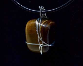 Pendant of Tiger Eye with a leather cord.