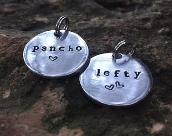 Dog tag.  Pet ID tags hand stamped from thick grade aluminum.