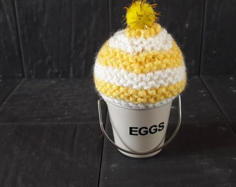 Hand knitted yellow and white egg warmer with bobble ideal Easter gift