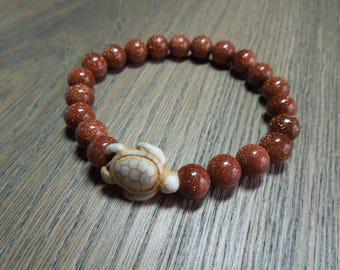 Goldstone beaded bracelet.