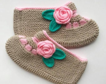 Hand-knitted, cute warm slippers with a pink rose