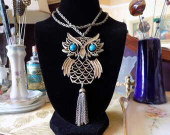 Cool 60's owl necklace with turquoise eyes.