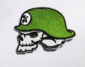 Skull wear green helmet patch.
