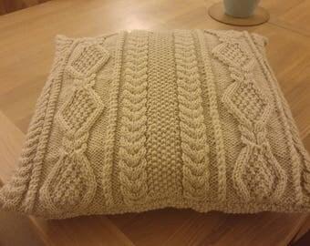 Knitted aran cushion
