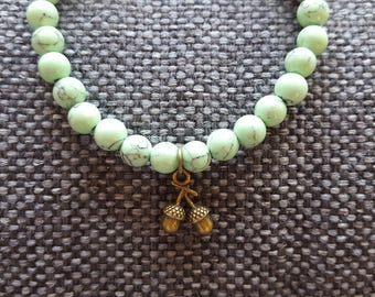 Bracelet with an acorn pendant