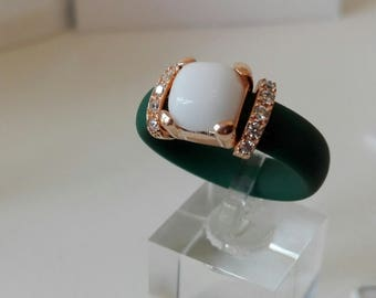 Green rubber ring with Zircons and white hard stone.  Available in different colors and stone-end