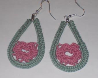 Handmade crochet teardrop earrings with a dusty rose flower and green trim.