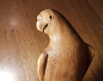 Vintage wood carving of parrot