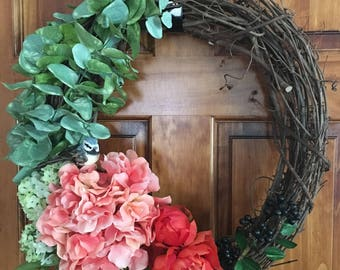 Peachy pink door wreath with eucalyptus/peony/hydrangea/bird