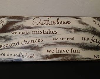 In this house sign.