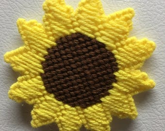 Sunflower refrigerator magnet made of plastic canvas and yarn with magnet glued to the backside