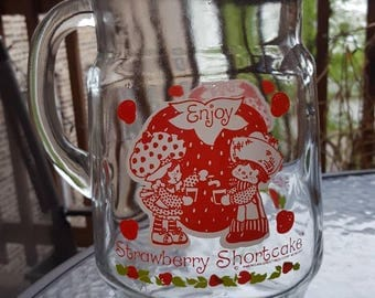 Strawberry Shortcake Vintage 1980s Collectable Pitcher featuring Huckleberry Pie. Bring nostalgia to your next party!