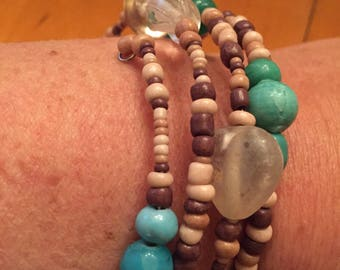 4 layer boho turquoise tans browns clear glass bracelet