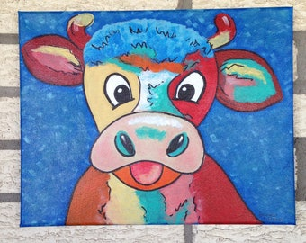This little cow needs a new home . He's got your attention . Colorful , fun, whimsy .