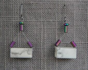 Lift. Earrings: White Howlite + Rainbow Hematite