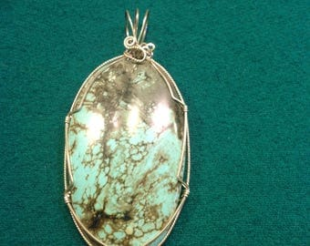 Turquoise wire wrapped pendant by artisan using sterling silver