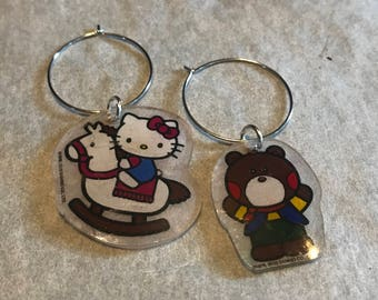Set of 2 Hello Kitty Shrinky Dinks wine glass charms.