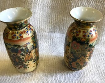 Asian colourful matching pair of Vases.